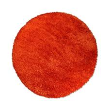 round rug in orange hover to zoom