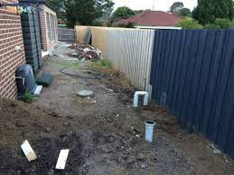 The first step was to construct a retaining wall across the whole back  boundary fence and part way along the side boundary fence. This would  provide a wall ...