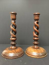 two twisted demountable wooden candlesticks set