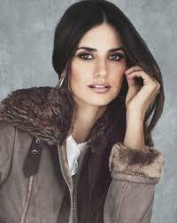 furry hood er jacket sleek straight hair browns and golds eye make up penelope cruz