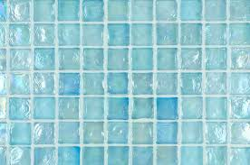glass grout iridescent glass mosaic tile in a and aqua blue color installed with translucent grout glass grout q grout color with white subway tiles