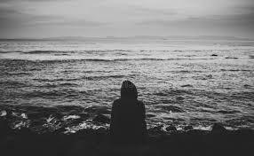 Personne Seul S'asseyant Par La Plage Photo stock - Image du plage, seul:  150235636
