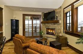 tv over stone fireplace this country home uses a stone fireplace for a lavish touch in