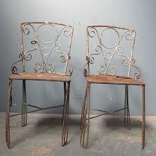 pair of decorative metal garden chairs