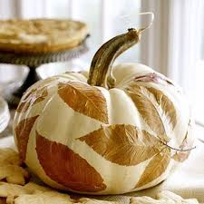 Decoupage is a great technique to make anything look better. Cover the  pumpkin in Mod