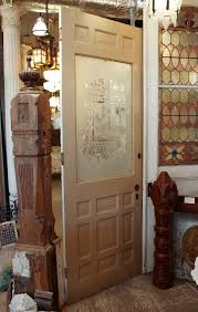 this is a gorgeous antique door with its original figural acid etched glass c