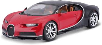 The bottom edge of the car is painted in a lighter, elegant tone of brown. Amazon Com 1 18 Bugatti Chiron Colors May Vary Toys Games