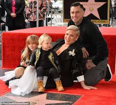 Carey Hart Birth Chart Pink Poses With Her Husband Carey Hart And Their Two