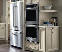 Kitchen cabinet for oven and microwave