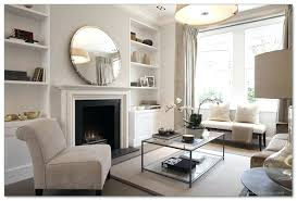 mirrors over fireplace mantels round mirror with brushed nickel frame over a simple modern white fireplace mirrors over fireplace mantels