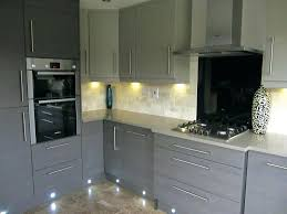 grey granite island dark countertops kitchen cabinets with