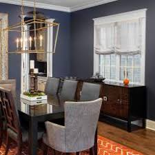 Transitional Navy Dining Room With Delicate Gold Chandelier