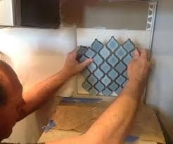 how to remove mirror tiles from wall arabesque blue tile backsplash using an adhesive mat how to kitchen backsplash kitchen design