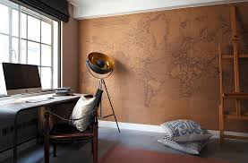 office trendy home office in industrial style with world map wall decor and vintage table