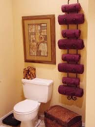 Bathroom Towel Storage Ideas: If you like the idea of using a wine rack for