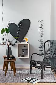 decorative chalkboards for various functions. Cozy Place To Sit With A Heart Shaped Chalkboard, Cheerful Text, Tags And Photo Frame. On The Side Tables Are Different Grey Vases Decorative Chalkboards For Various Functions