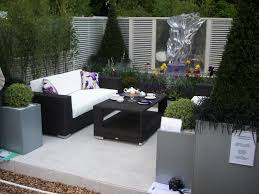 modern design outdoor furniture decorate. beautiful cushions on modern outdoor furniture combined with charming flowers and green plants at patio design decorate g
