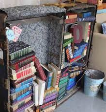 Whimsical furniture and decor Crazy Painted Old Books Gain New Life Cut Into Monograms For Shelf Decorations Bizbash Johnson City Press Rustic And Repurposed Redeemables Offers