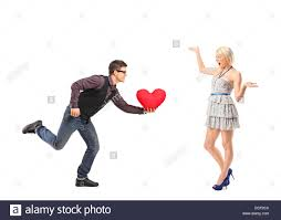 Man Shaped Pillow A Man Running With A Red Heart Shaped Pillow In His Hand And An