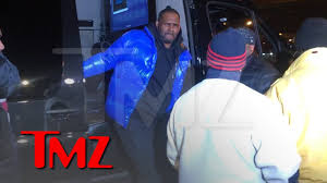 R. Kelly Turns Himself In To Police After Being Charged With Sexual ...