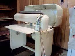 kenmore iron. mangle - the kenmore ironer. mom kept one in back room closet and would use it to iron pillowcases tablecloths, before permanent press. i