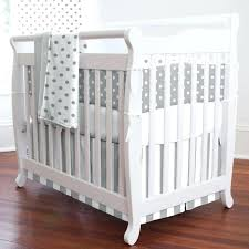 portacrib crib sheets in white also wooden floor for nursery