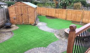 shed and dirt lawn how to lay artificial grass on a curved lawn