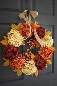 Dried hydrangeas in orange, deep red and light yellow shades glued to a  wreath are