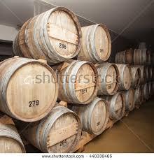 stacked oak barrels wine barrels in cellar cavernous wine cellar with stacked oak barrels barrel office barrel middot