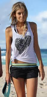Rochelle Fox enjoys beach side workout after racy swimsuit shoot.