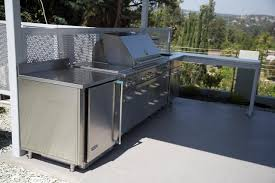 stainless steel outdoor kitchen with grill cover compact refrigerator and bar table outstanding stainless steel