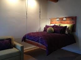 Appealing Wooden Suspended Bed Frame Combine Purple Bed Sheet Also  Unfinished Wooden Headboard