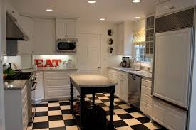 grandiose traditional kitchen decors with square marble tops small kitchen island also white painted kitchen cabinets set on checd floor feat ceiling