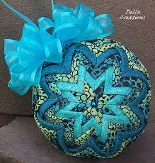Quilted Ornament in Turquoise, Black, & Light Green Animal Print ... & Visit the DellaCreations Etsy shop for more handcrafted quilted ornaments.  a-handcrafted-christmas Adamdwight.com