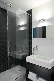 shower doors of austin with contemporary bathroom and black shower tile black tile wall glass shower door one handle faucet sliding door sliding shower door