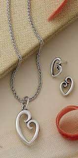 shown on a light spiga chain and