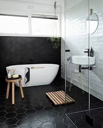 black hexagon tiles with white grout and white tiles create a bold contrasting look