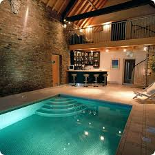 When most people think of swimming pool designs, particularly at someone's  home, indoor pools probably aren't the first thing that pop into their  heads.