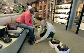 low paying jobs in minnesota are paying a bit higher startribune com mary perkins left received help from shoe sperson matt morseth at schuler shoes