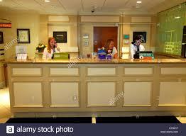 maine freeport hilton garden inn motel hotel lobby front desk clerk employee woman man job service