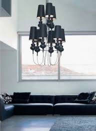 with black electrical cords hanging from each light the wiring is designer to become a feature for this chandelier it is a classical style fitting with a