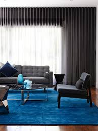 impressive mohawk area rugs in living room contemporary with blue carpet next to area rug on carpeting alongside wood floor and modern living room blue i98 rugs
