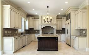 kitchen with antique white cabinets and dark brown center island with beige granite countertops