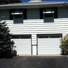 steel raised panel garage door in a long panel design with stockton inserts