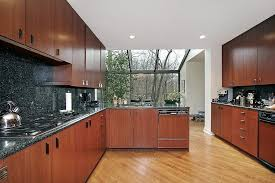 modern kitchen cabinets cherry. Modern Kitchen Installed Cherry Wood Cupboards And Black Countertops With Laminate Flooring Cabinets S