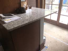 the same quartz as the countertop is installed at desk height in the new kitchen home office workspace message center