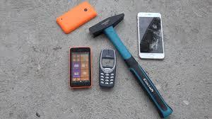 nokia 3310 vs iphone 5. nokia 3310 vs iphone 5 e