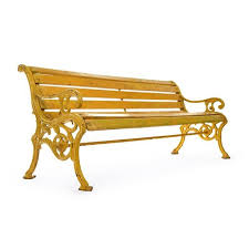 wooden bench in cast yellow patina for