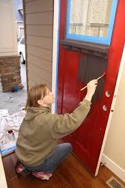 painting front doorA Front Door Makeover From Brown To Red Glidden Trim  Door Paint