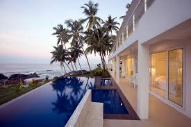 infinity pool house. This Infinity Pool Serves Multiple Resort Rooms, All Behind Sliding Glass Doors. Manicured Grass House I